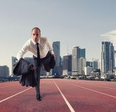 Businessman acts like a runner. Competition and challenge in business concept. Businessman acts like a runner on a track. Competition and challenge in business Stock Photos