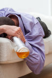 Businessman addicted to alcohol sleeping. On the coach in a shirt Stock Photography