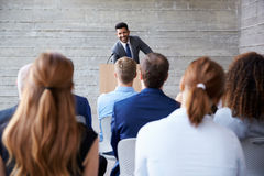 Businessman Addressing Delegates At Conference Stock Image