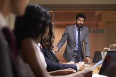 Businessman addressing team at a meeting, low angle close up royalty free stock photo