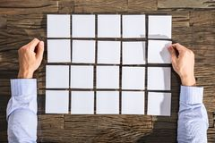 Businessman With Adhesive Notes On Desk Royalty Free Stock Photos