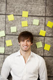 Businessman With Adhesive Notes On Wooden Wall Stock Image