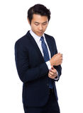 Businessman adjust his cufflink Royalty Free Stock Photo