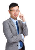 Businessman adjust his glasses Royalty Free Stock Photography