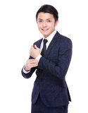 Businessman adjust his suit sleeve Stock Photography