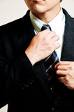 Businessman adjust necktie Royalty Free Stock Photo