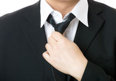 Businessman adjust tie Stock Photography