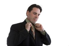 Businessman adjusting collar Stock Images
