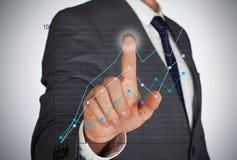 Businessman adjusting graph Royalty Free Stock Images