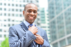 Businessman adjusting his collar outdoors Royalty Free Stock Photography