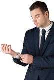 Businessman adjusting his cuffs on shirt Royalty Free Stock Images