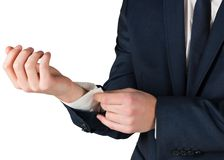Businessman adjusting his cuffs on shirt Stock Photography