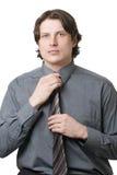 Businessman adjusting his necktie Stock Image
