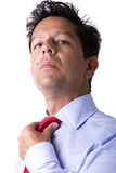 Businessman adjusting his necktie Stock Photography