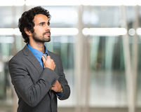 Businessman adjusting his necktie Royalty Free Stock Photo