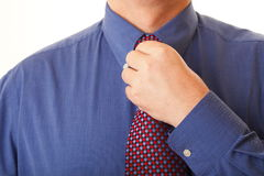 Businessman adjusting his tie Royalty Free Stock Photo
