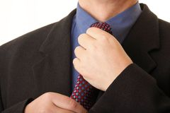 Businessman adjusting his tie Stock Photo