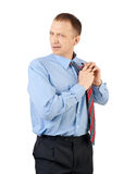 Businessman adjusting his tie Royalty Free Stock Photos