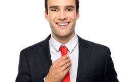 Businessman adjusting his tie Stock Photography