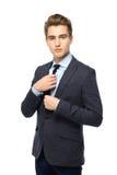 Businessman adjusting his tie Royalty Free Stock Image