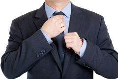 Businessman adjusting his tie Stock Photos