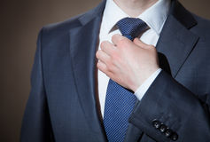Businessman adjusting his tie Stock Image