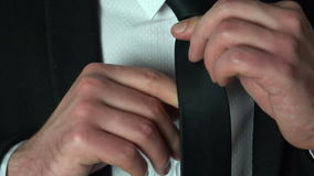 Businessman adjusting his tie stock video