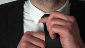 Businessman adjusting his tie stock video footage