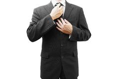 Businessman adjusting his tie, isolated on white Royalty Free Stock Image