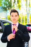 Businessman adjusting his tie. Proud businessman adjusting his appearance before entering a meeting Royalty Free Stock Photos