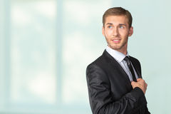 Businessman adjusting his tie Stock Image