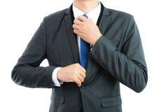 Businessman adjusting necktie isolated Royalty Free Stock Image