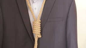Businessman adjusting a noose rope like tie, going on not your favorite job, stock video