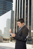 Businessman adjusting shirt cuff link outdoors exterior office building Royalty Free Stock Images
