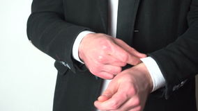 Businessman adjusting sleeve cuffs of his shirt stock video footage