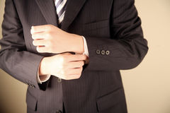 Businessman adjusting suit Royalty Free Stock Photo