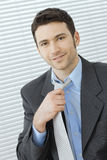 Businessman adjusting tie Royalty Free Stock Photography