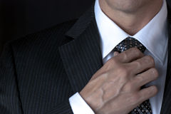 Businessman Adjusting Tie Royalty Free Stock Photo