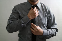 Businessman adjusting tie,Front view, no head. Concept of workin. G in an office Stock Images