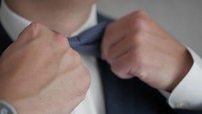 Businessman adjusts his tie stock footage