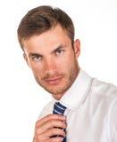 Businessman adjusts his tie Stock Images