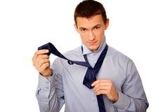 Businessman adjusts a tie royalty free stock photos