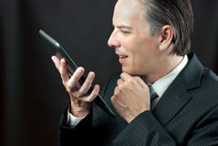 Businessman Admires Tablet Royalty Free Stock Photo