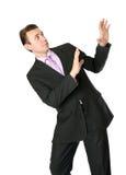 Businessman is afraid of something Stock Image