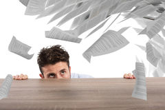 Businessman afraid under the desk. concept of overwork Stock Images