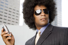 A businessman with an Afro hairstyle talking on a mobile phone Stock Image