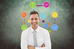 Businessman against apps in background Royalty Free Stock Image