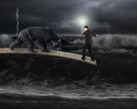 Businessman against bear balancing on plank with dark stormy oce Royalty Free Stock Images