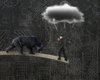 Businessman against bear balancing on plank with gray cloud rain. Businessman against black bear balancing on plank with gray cloud raining lightning and doodles Royalty Free Stock Photos