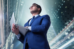 The businessman against buildings in business concept Stock Image
